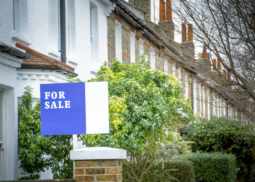 house for sale sign on a property